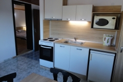 Апартамент под наем - кухня
